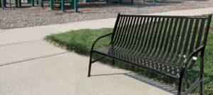 Witt 6 Foot Black Bench in Outdoor Environment