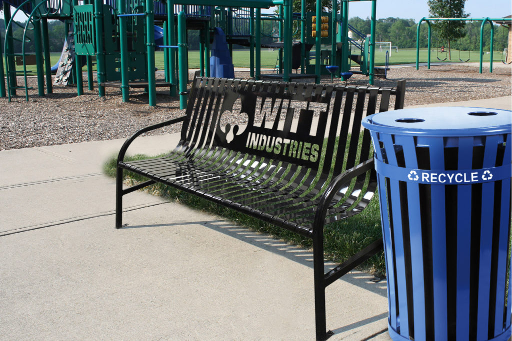 Witt 6 Foot Black Bench and Blue Oakley Standard Recycling Receptacle in Outdoor Environment